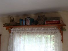 """""""Some time ago someone posted an idea to use shelves over windows. I had commented that I did the same thing only I used wooden door gingerbread trim to make the side brackets so that I could hang my curtain rods through them."""" Good idea. ~ T"""