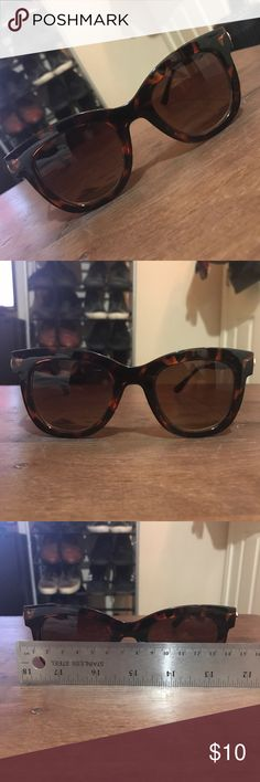 Tortoiseshell Glasses These sunglasses will keep you looking stylish this summer with the classic tortoiseshell coloring with gold accents. Accessories Sunglasses
