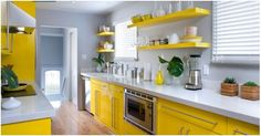 Lemon yellow and gray kitchen. What happened to those yellow shelves at Ikea? I need one! They're gone.