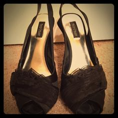 White House Black Market Black Ruffle Pumps Size 8 EXCELLENT condition! Beautiful, unique shoes. So elegant - photos don't do a justice. Satin with chiffon ruffle detailing on the top. Sling back with elastic strap, stays on very well. Open toe. VERY comfortable! True to size 8. White House Black Market Shoes Heels