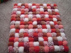 This is such a soft, cozy, comfortable pom pom rug. This would be perfect for newborn photos or even home decor. Layers of shades or coral, peach,