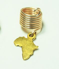 Gold+Africa+shaped+charm+with+gold+ring.+For+#2+pencil+sized+locs.