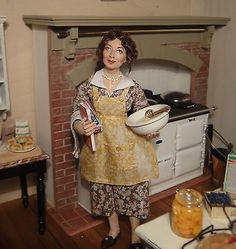 Sherri Colvin - hand sculpted mom cooking dinner, dressed in fine lawns, batistes, silks and English wools, then hand draped and set.   sold on ebay for $358.99