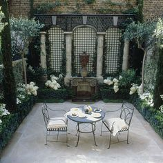 Small neo-classical courtyard using columns, treillage + box hedging. I'd like mirrors behind the trellis to create more depth. Outdoor Rooms, Outdoor Gardens, Outdoor Living, Outdoor Decor, Formal Gardens, Pergola, Small Courtyards, Enchanted Home, White Gardens