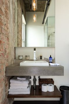 Like this industrial look of brickwork, grey and timber. Hermann Loft Renovation - industrial - Bathroom - Houston - C O N T E N T Architecture