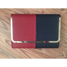 Red / Black /Gold Clutch Used once, a little scuff on the left side of the bag as shown within the photo. Can be worn as a clutch or a cross body. It is black I believe or a really dark blue but I'm pretty sure it's black. Let me know if you have any questions Bags Crossbody Bags