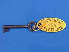 """RMS Titanic: Second Officer David Blair OBE. Iron key with brass oval tag attached """"Crows Nest Telephone Key""""."""