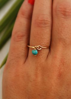 14K gold ring with turquoise dangle. http://www.etsy.com/listing/85127844/any-size-turquoise-ring-gold-14k-gold?ref=sr_gallery_12&ga_search_submit=&ga_search_query=turquoise+ring&ga_view_type=gallery&ga_ship_to=US&ga_page=2&ga_search_type=handmade&ga_facet=handmade