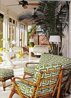 Love the fresh appeal of this enclosed patio. The Greek key on the chairs helps.