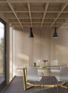 Doyle Gardens extension by Jonathan Tuckey features a criss-crossing wooden…