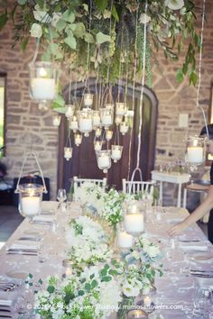 hanging candles at a wedding reception Hanging Centerpiece, Hanging Candles, Hanging Lights, Centerpieces, Hanging Chandelier, Candle Chandelier, Hanging Flowers, Floating Candles, Votive Candles