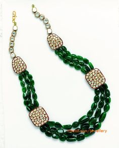Emerald and uncut diamond necklace