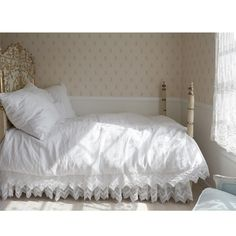 The Cluny Lace Bedding Collection pairs soft, washed linen with cotton lace for dreamy repose. The white design is finished with a hidden zip closure for sophisticated functionality.