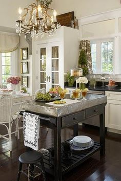 Love the simplicity of this kitchen with the chandelier adding a touch of elegance :)