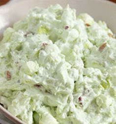 Watergate Salad: I can (20oz.) crushed pineapple in juice, undrained, 1 pkg. (3.4 oz) jello pistachio instant pudding, 1 cup marshmallows, 1/2 cup chopped pecans, 1 1/2 cups thawed cool whip. mix 1st 4 ingredients in large bowl. Stir in cool whip and refrigerate at least 1 hour before serving