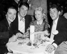 Nancy and Ronald Reagan, Jeannie and Dean Martin.