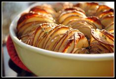 """Crispy Potato Roast ~ 2 Tbsp butter, melted; 2 TBsp Olive Oil; 3 lb russet potatoes; 4 shallots, sliced thick; 1 tsp coarse salt; 8 sprigs thyme ~ Preheat oven to 375°. Combine butter & oil. Brush bottom of a round 9"""" baking dish w/ butter mixture. Slice potatoes very thinly crosswise & arrange in dish. Wedge in shallots.  Sprinkle w/ salt & brush w/ butter. Bake 1 hr, 15 min. Add thyme; bake until potatoes are cooked through w/ a crisp top, ~35 minutes. ~  175 cal; 6g fat; 31g carb; 5g…"""