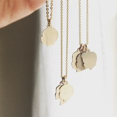 Custom Silhouette Charms Tiny Charm Necklace 14K Gold Filled or Sterling Silver Silhouette Necklace From your photos Dainty Gold Necklace by LePapierStudio on Etsy https://www.etsy.com/listing/158717664/custom-silhouette-charms-tiny-charm