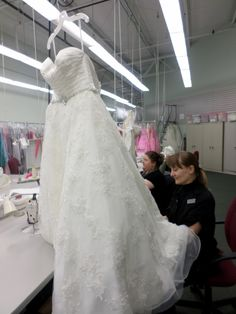 Catan Fashions, the country's largest destination bridal salon -- located just minutes from Cleveland Hopkins Airport -- features its own on-site alterations department. Here one of our expert seamstresses is altering a custom-made wedding gown for a customer. www.catanfashions.com