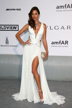 Alessandra Ambrosio wearing a magnificent Roberto Cavalli gown at the amfAR Cannes 2014 Gala.