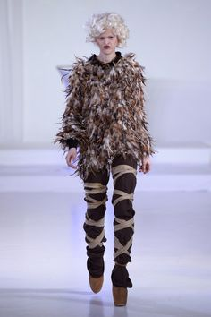 Made me laugh so hard.......This dead quail. | 16 WTF Photos That Prove Fashion Designers Have Lost Their Minds