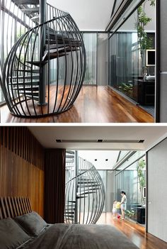 HYLA designed this modern family home in Singapore. This sculptural and modern black metal spiral staircase looks more like a birdcage with the black metal rods curving around the spiraling steps. Interior Design Minimalist, Modern House Design, Exterior Stairs, Interior And Exterior, Modern Exterior, Stairs Architecture, Interior Architecture, Tamizo Architects, Stair Handrail