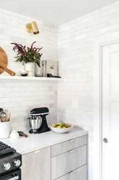 Pretty backsplash up to the ceiling and a rad floating shelf that adds some spunk to the flow! Awesome!