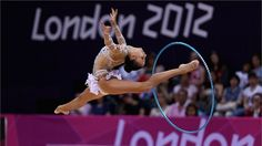 Daria Dmitrieva of Russia performs with the hoop during the Rhythmic Gymnastics qualification on Day 13 of the London 2012 Olympic Games at Wembley Arena. Dmitrieva leads at the close of the first day of qualification.