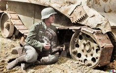 WWII colorized ~ A Kriegsberichter (war correspondent) holding an Arriflex 35 2 1942 camera ACR 0292 and he is leaning against a knocked out Soviet light tank. (Colorized by Royston Leonard from the UK) German Soldiers Ww2, German Army, Military Photos, Military History, Military Army, Luftwaffe, Colorized Photos, Colorized History, Man Of War