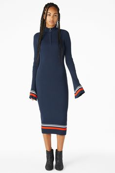 <p>Cling's the thing with this finely ribbed sweater dress with a zip 1/2 polo neck and long bell sleeves. <br /><br />In a size small the chest width is 66