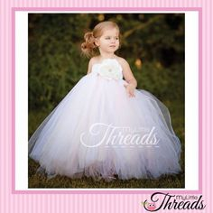 Are you getting MARRIED and looking for a BEAUTIFUL FLOWER GIRL DRESS?!!??? We are now taking orders for our Gorgeous 'Isabella' Bridesmaid's Dress that has lots and lots of tulle.... Strapless stretch crochet, with white diamanté flower with white and very light pink champagne tulle...