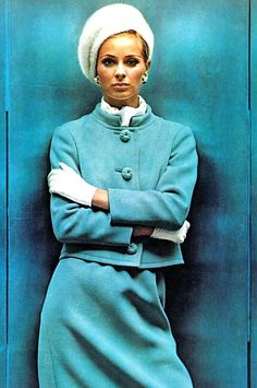 Camilla Sparv in a pale blue wool suit with mandarin collar and braid buttons by Seymour Fox, photo by Helmut Newton for Vogue US September 1965