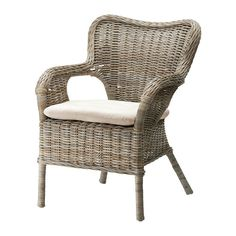 4 wicker chairs with a small round white table for a breakfast nook