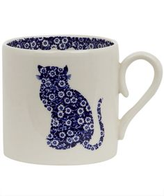 Calico cat mug and a warm cup of tea on a fall day