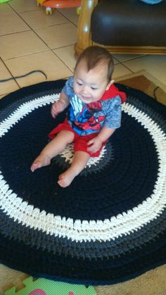 Tarn tug fun with baby he was so excited to finally sit on it... Richardscreations.wordpress.com Follow me Tarn Rug Mishca Richards on FB as well Pattern made up as i go.starting with magic circle dc 16 time in circle then the math pattern 2 1 2 1 then 2 11 2 then 2 111 2 and so on...