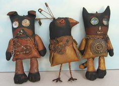 Steampunk Buddies by Susan Barmore Item # This dog, bird and cat trio has joined forces in the New Reality. Gears, watch parts, beads and weathered safety pins form some of the eye catching embellishments on these painted muslin figures. Ugly Dolls, Creepy Dolls, Primitive Folk Art, Primitive Crafts, Fabric Dolls, Fabric Art, Wall Fabric, Softies, Textiles