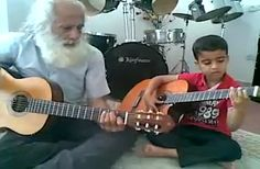 The love of music is one of the best things you can pass down to your children.   This boy is an amazing guitarist!  Even more so because he's playing lead and his grandfather is playing the chords. A few minutes into the song the boy starts singing.  Wonderful. ♥