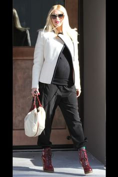 A tailored white moto jacket adds style and street cred to an otherwise all-black look.   - HarpersBAZAAR.com