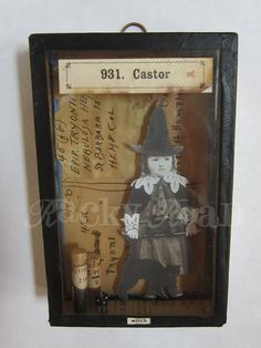little witch in a vintage specimen box