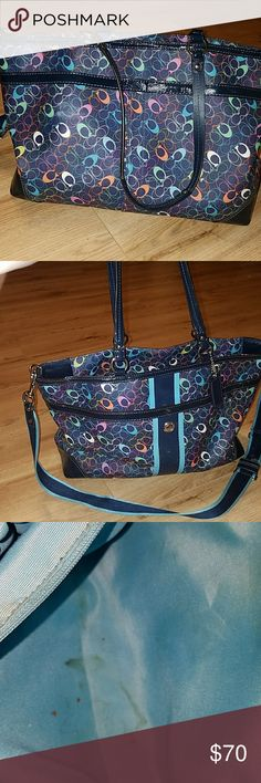 Coach diaper bag Good condition with a few yellow stains from sweet potatoes and carrots being accidently opened while me and the kids were out running errands, I tried getting them out by using my nails but im having issues getting those stains out so price will reflect that. Its a very nice bag other then those stains. Im hoping someone can get the stains out. Coach Accessories Bags