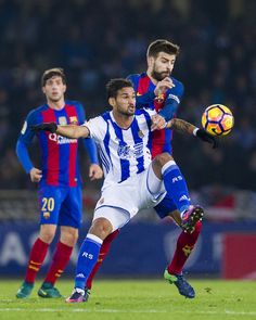 Gerard Pique of FC Barcelona duels for the ball with Willian Jose Da Silva of Real Sociedad during the La Liga match between Real Sociedad de Futbol and FC Barcelona at Estadio Anoeta on November 27, 2016 in San Sebastian, Spain.