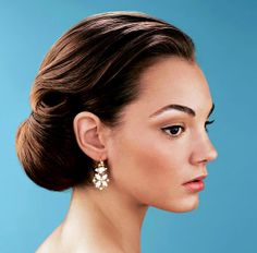 """so pretty. """"This neatly rolled 'do has a classic Grace Kelly appeal"""" Read more: http://www.nydailynews.com/lifestyle/galleries/easy_bridal_dos/easy_bridal_dos.html#ixzz1TWRXTPB7"""
