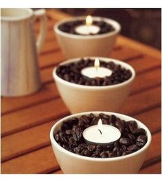 DIY coffee scented candles. Pour beans (the cheaper the better) into a jar, nestle a vanilla tealight in snugly. It smells like a fresh pot of vanilla coffee.