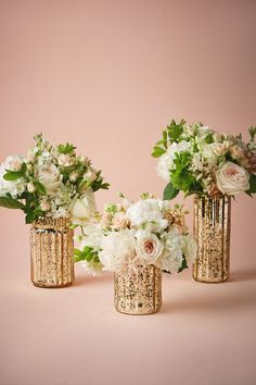 Wedding Flower Decoration Fluted Mercury Vases - With a warm gold tint, crackled mercury glass adds an understated elegance to table tops. Only available at BHLDN Style Mercury Glass Centerpiece, Glass Centerpieces, Centerpiece Decorations, Wedding Decorations, Mercury Glass Wedding, Hurricane Vase, Engagement Party Centerpieces, Vintage Wedding Centerpieces, Decor Wedding