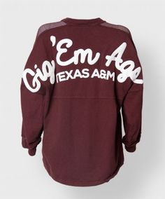 """This sporty version of our popular maroon spirit jersey features mesh panels on the fronts of the sleeves and on the shoulders. The back reads """"Gig 'Em Ags"""" and """"Texas A&M"""" in a thick white puffy paint"""