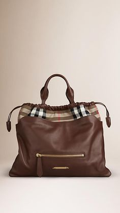 Burberry Brown Ochre The Big Crush in House Check and Leather - A supple calf leather bag with distinctive House check cotton detail. Referencing classic outerwear, the bag fastens with a leather drawcord, while the interior features a secure zip pocket and pouch. A detachable shoulder strap, hand-painted edges and polished metal hardware complete the design. Discover the women's bags collection at Burberry.com