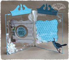 Sizzix Accordion Album cut from clear and decorated with Tim Holtz Pediments die, plus Frame & Label die.