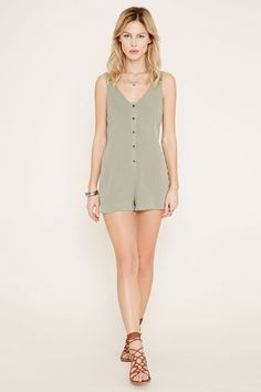 Style Deals - A crinkled woven crepe romper with a sleeveless cut, buttoned front, V-neckline, and a V-cut back.