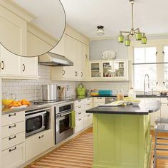thisoldhouse.com | from 39 Crown Molding Design Ideas - really like so many drawers, island diff color, small glass cab