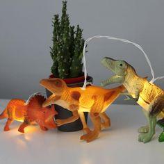 String Lights with Natural Dinosaurs. LOVE these string lights. #garlandlights #stringlights #dinosaurlights #kidsbedrooms #boysbedroom #babiesbedroom #childrensbedroom #bornandbredstudio